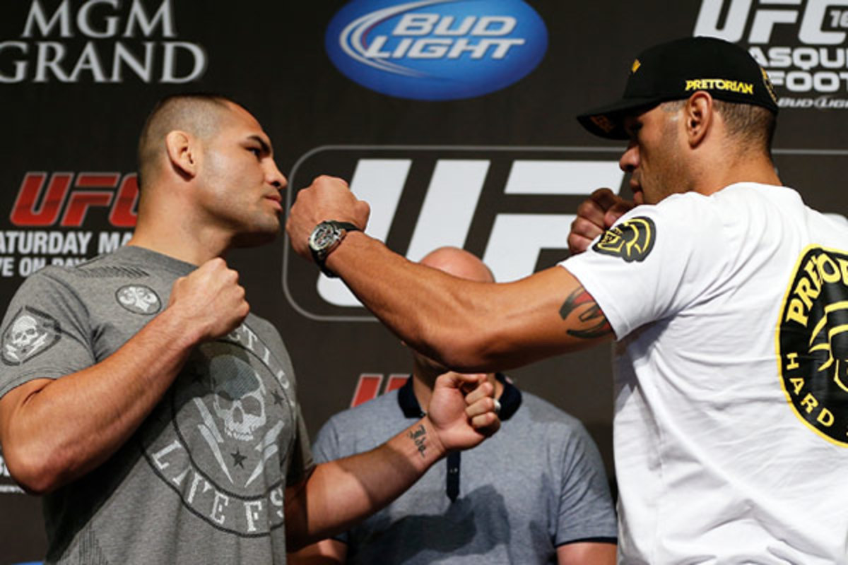 All three of SI.com's UFC experts predict Cain Velasquez (left) to defeat Antonio Silva. (Zuffa LLC via Getty Images)