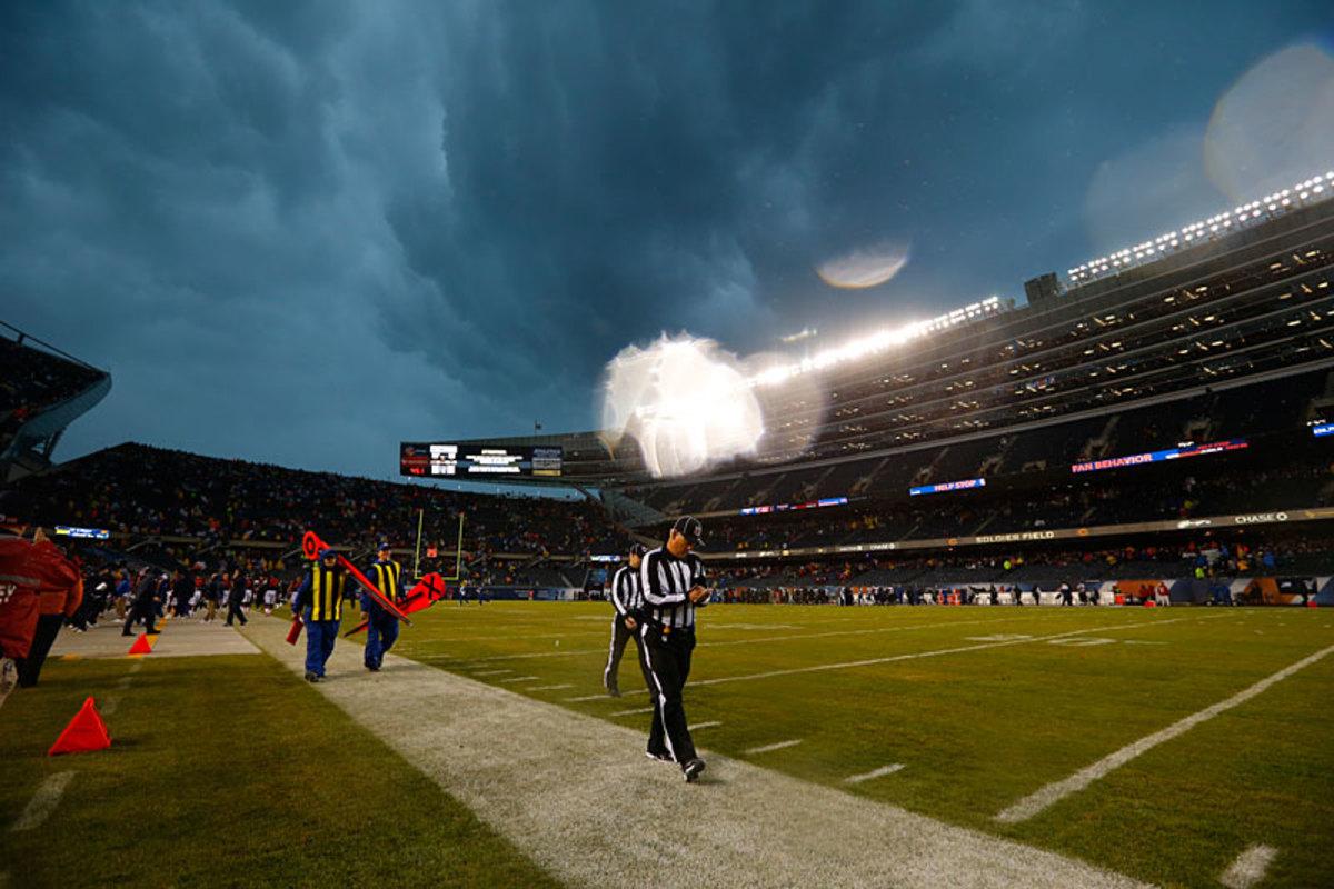 The officials flee harsh weather; Ravens at Bears, Week 11. (Jeff Haynes)