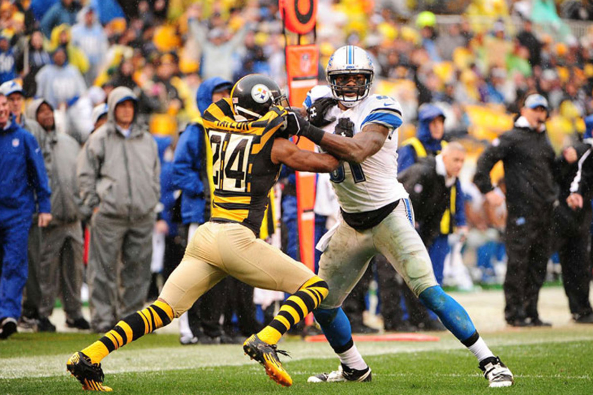 Calvin Johnson and Ike Taylor tussle at the line. (Fred Vuich)