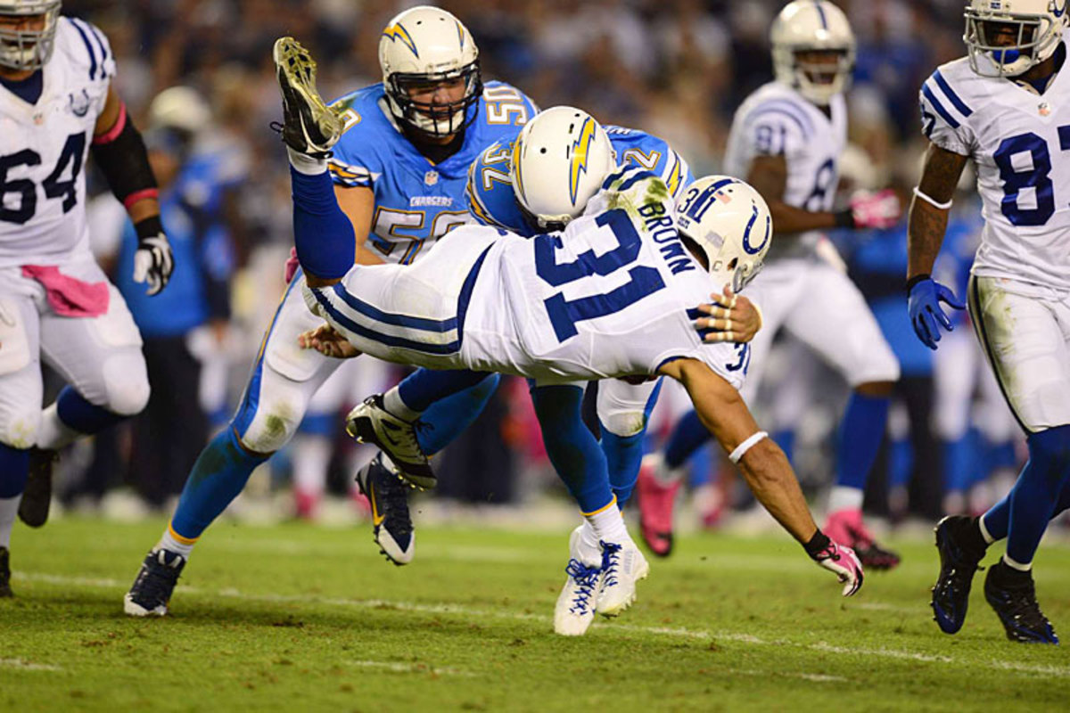 San Diego's Eric Weddle puts a hit on Indy's Donald Brown in the Week 6 Monday nighter. (John Biever)