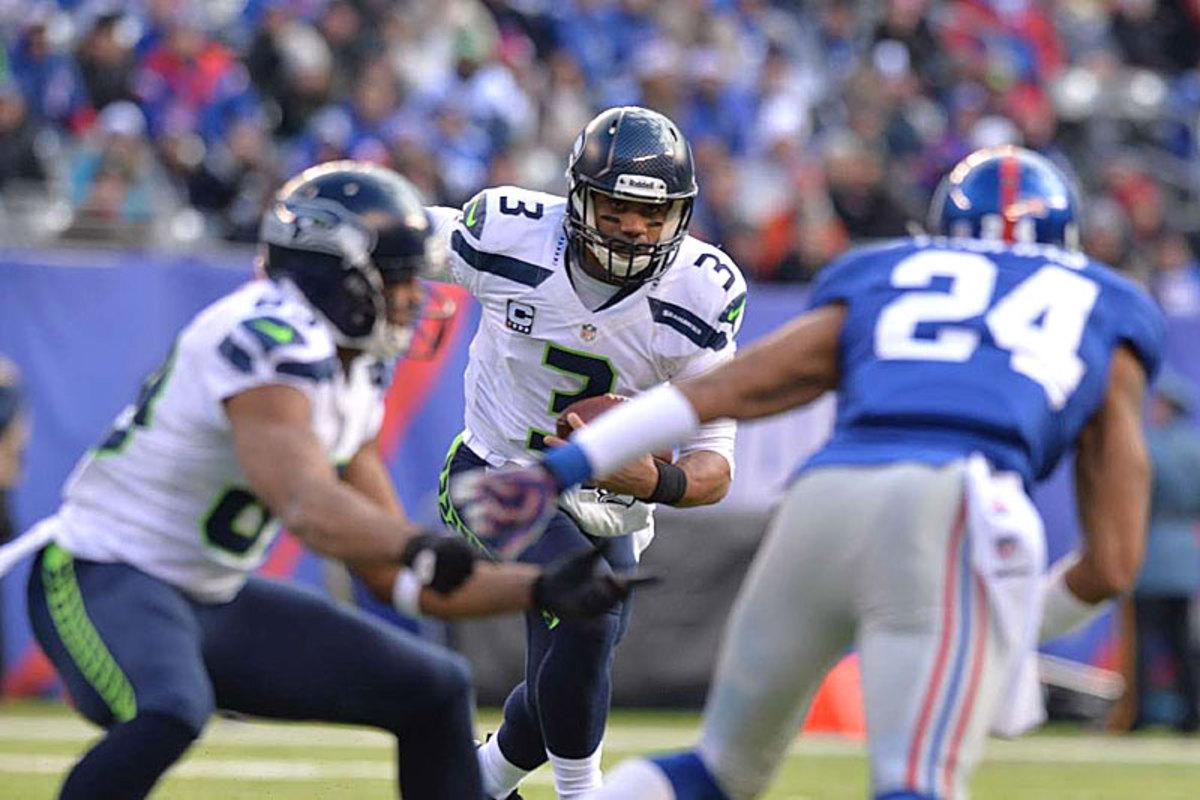 Russell Wilson eyes the prize against the Giants in Week 15. (Carlos M. Saavedra)