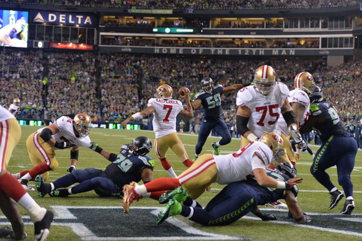 Mayhem in the endzone as the Seahawks pressure Colin Kaepernick. (Robert Beck)