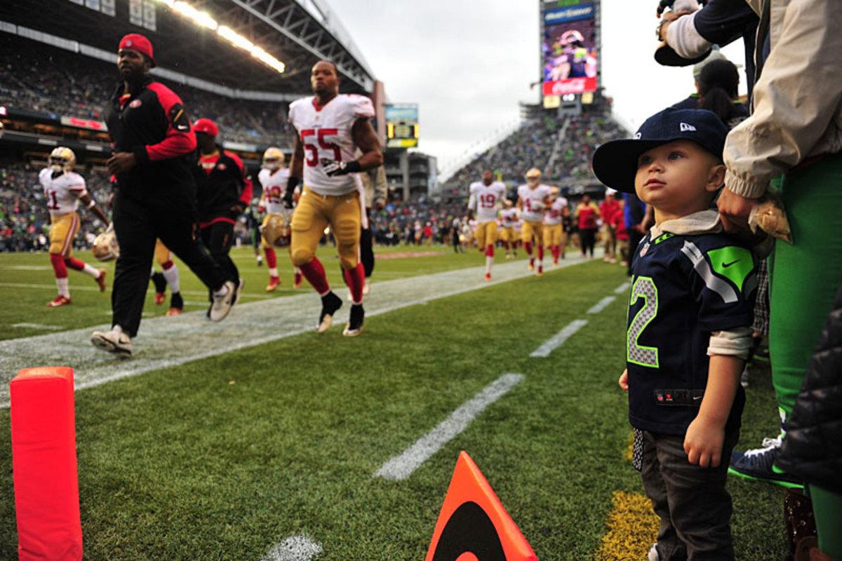 A 12th kid absorbs the Seattle-SF pregame scene. (Robert Beck)