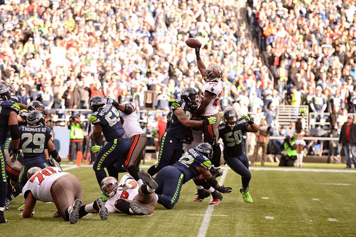 Week 9 weirdness: Running back Mike James's jump-pass TD put Tampa Bay up 21-0 at Seattle. (Robert Beck)
