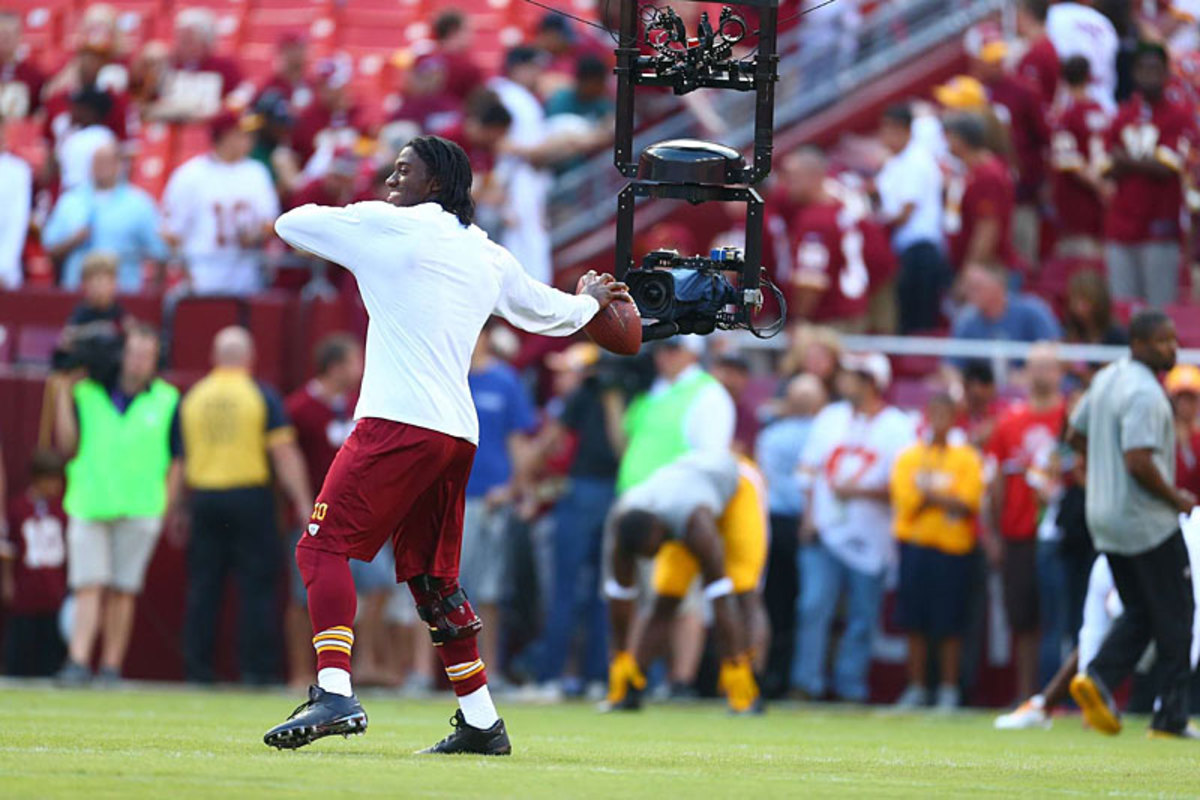 All eyes on Robert Griffin III and his surgically repaired knee in the opener against the Eagles. (Simon Bruty)