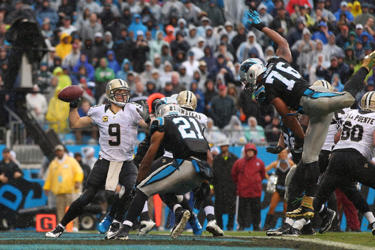 The Panthers' rush brings the heat against Drew Brees. (Chris Keane)