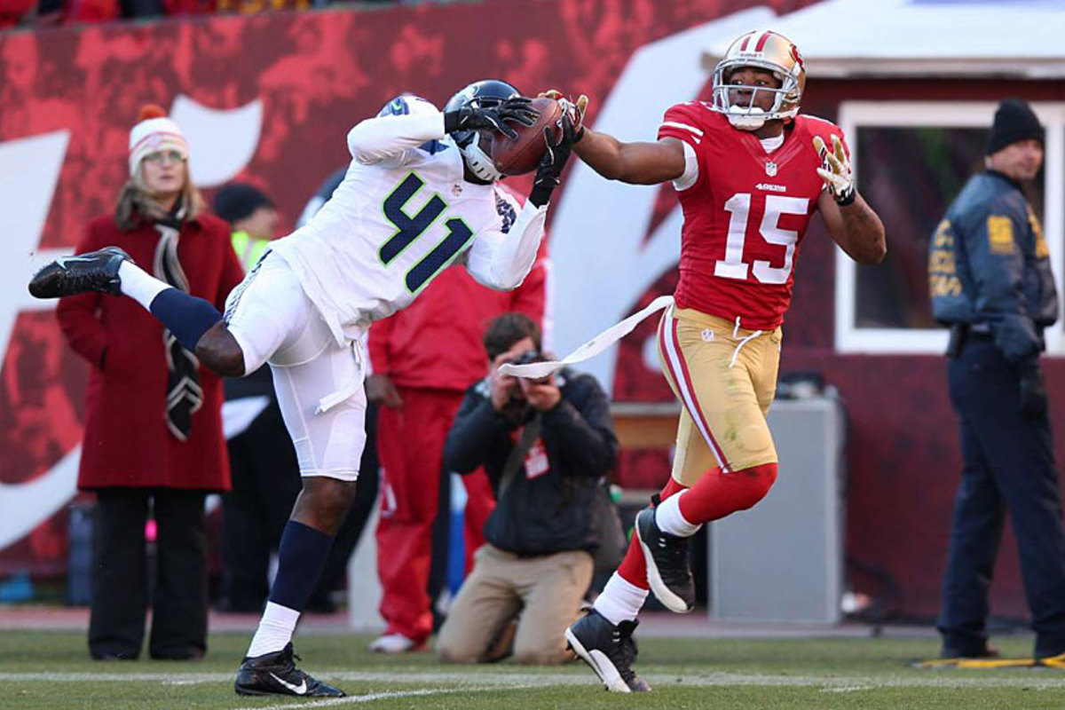Seattle's Bryon Maxwell defends a pass to Michael Crabtree at the Stick in Week 14. (Jed Jacobsohn)