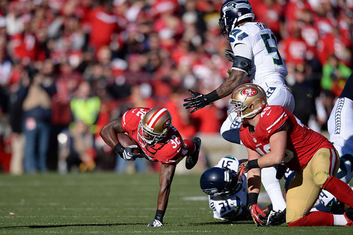 Niners RB Kendall Hunter, going the extra yard against the Seahawks. (Jed Jacobsohn)