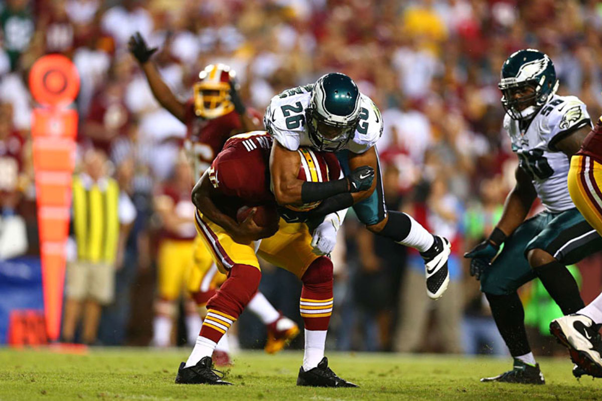 Philly's Cary Williams lays a hit on RG3 in the Eagles's Week 1 win at Washington. (Simon Bruty)