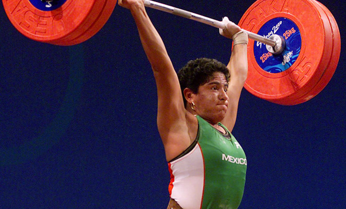 Soraya Jimenez of Mexico, completes a final lift to win the gold medal in the clean and jerk event of the women's 58 kg weightlifting competition at the Summer Olympic Games in Sydney, Australia.