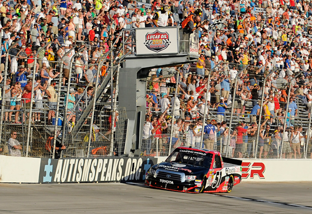 Kyle Busch took a step toward a NASCAR triple-header in Dover by winning the Truck Series race Friday.