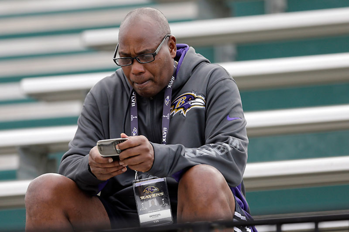 Newsome cultivates a personal touch with his players and is a common sight at Ravens practices. (Patrick Semansky/AP)