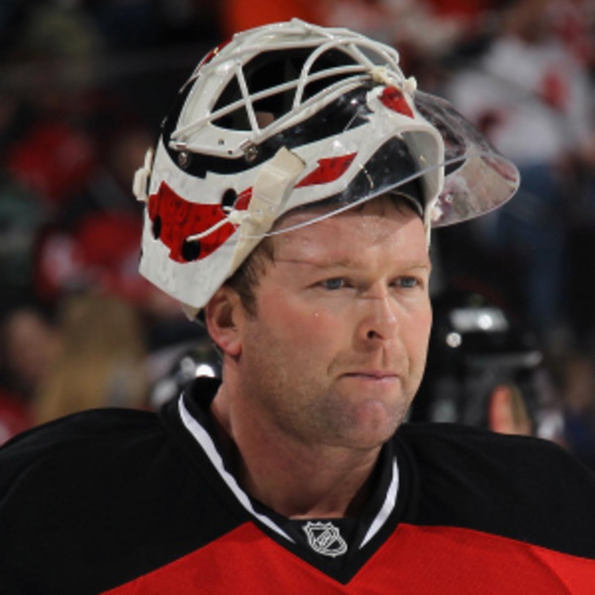 Martin Brodeur will return Tuesday for Devils-Rangers. (Bruce Bennett/Getty Images)