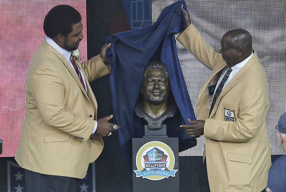 Seventeen years after he made him the Ravens' first draft pick, Newsome helped Jonathan Ogden unveil his bust in Canton this summer. (Tony Dejak/AP)
