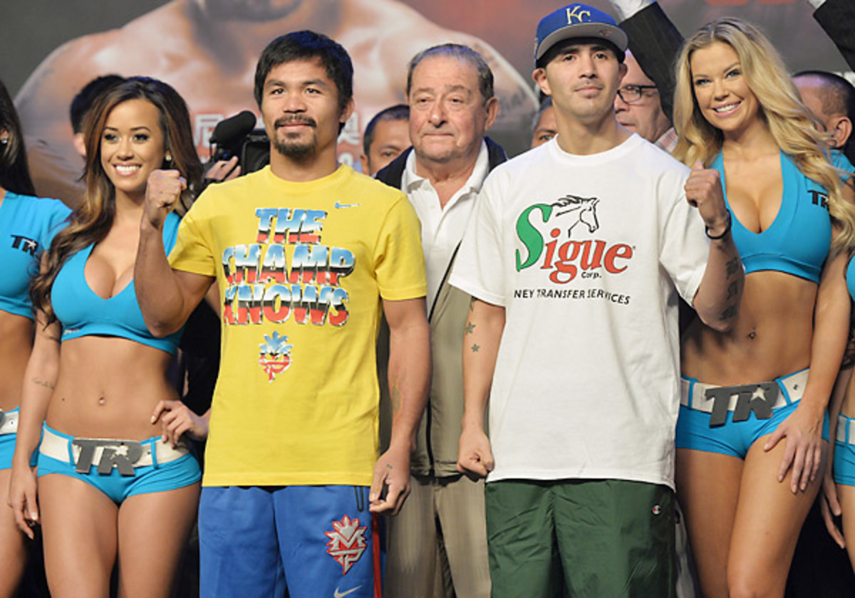 Manny Pacquiao (left) shook off an 11-month layoff to defeat Brandon Rios in a unanimous decision. (Dale de la Rey/AFP/Getty Images)