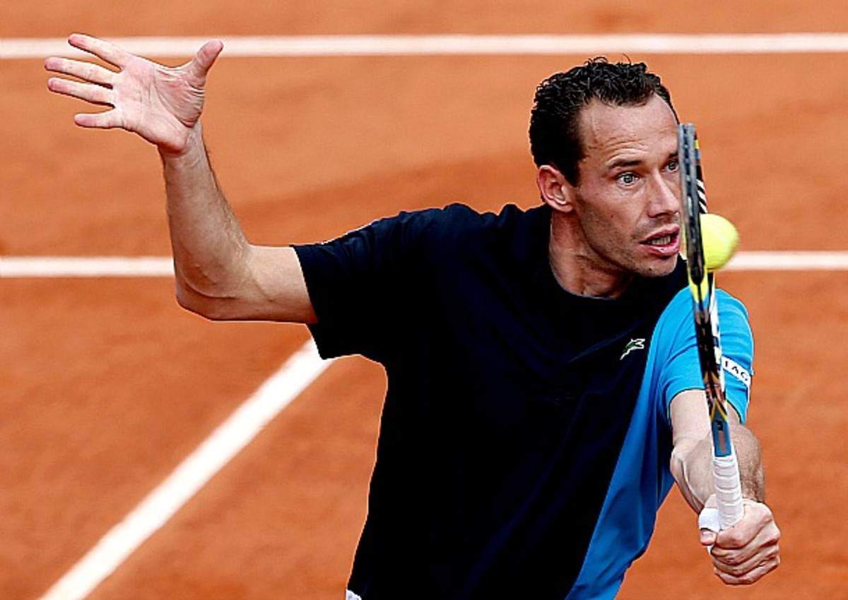 France's Michael Llodra returns the ball to Belgium's Steve Darcis during their first round match of the French Open tennis tournament at the Roland Garros stadium Sunday, May 26, 2013 in Paris. (AP Photo/Petr David Josek)