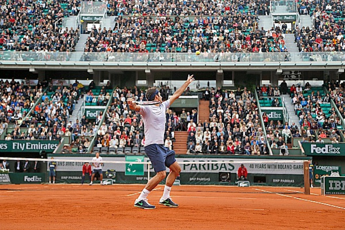 Switzerland's Roger Federer prepares to serve against Spain's Pablo Carreno Busto in their first round match of the French Open tennis tournament, at Roland Garros stadium in Paris, Sunday, May 26, 2013. (AP Photo/Petr David Josek)
