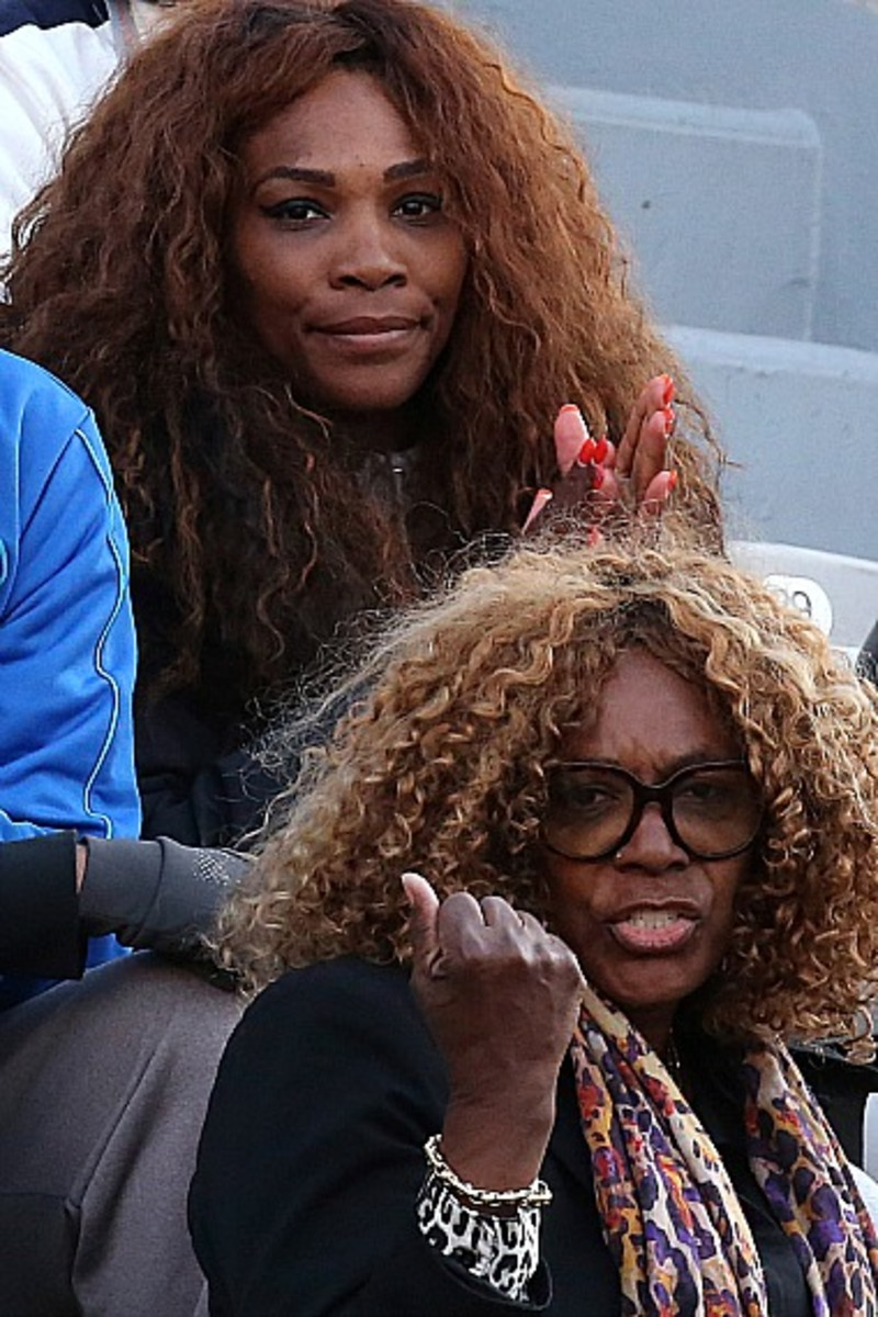 Oracene Price, bottom, mother of Serena, top, and Venus Williams of the U.S., center, watches her daughter Venus' first round match against Poland's Urszula Radwanska at the French Open tennis tournament in Roland Garros stadium in Paris, Sunday, May 26, 2013. (AP Photo/Michel Euler)