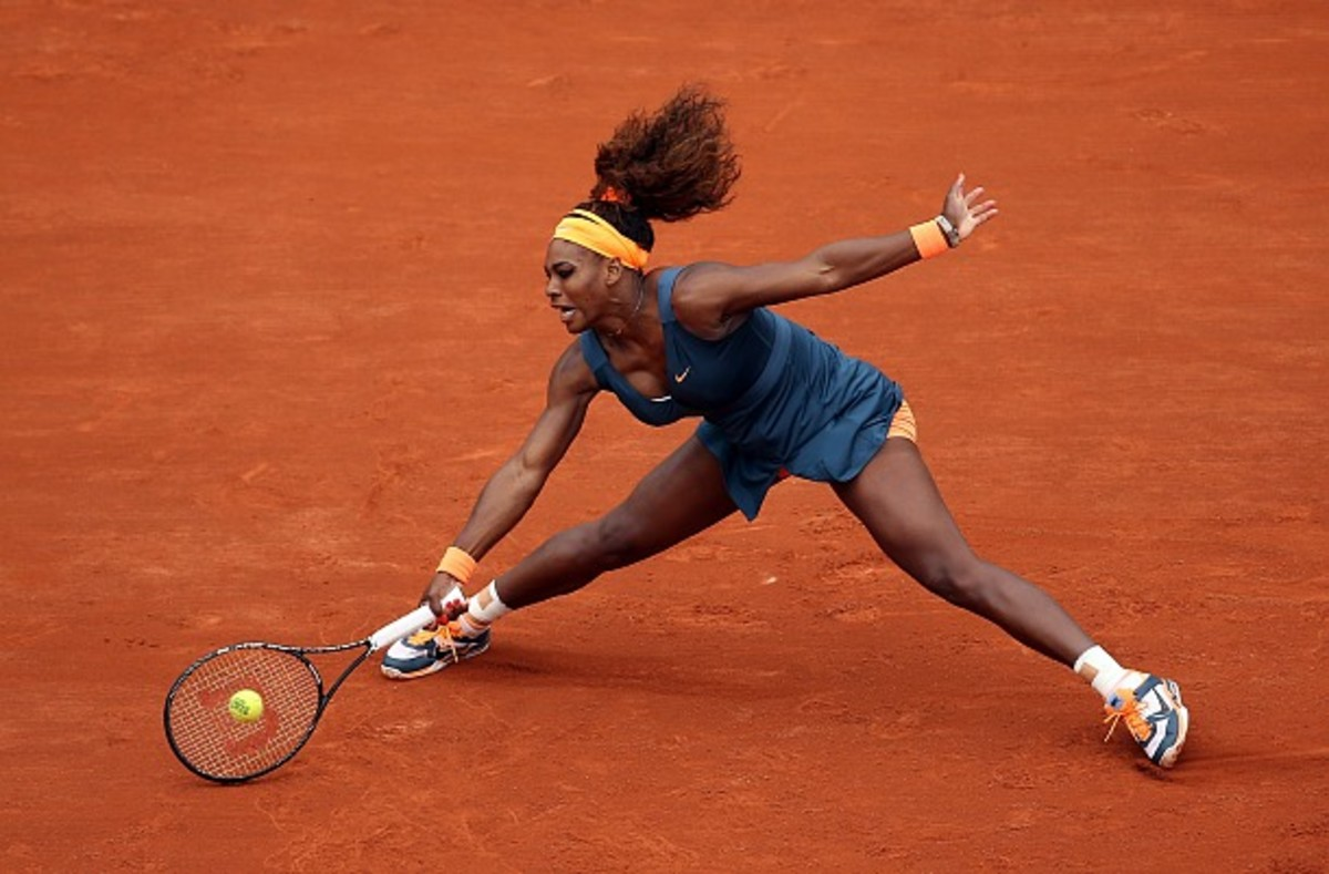 PARIS, FRANCE - MAY 26: Serena Williams of the United States of America plays a forehand in her Women's Singles match against Anna Tatishvili of Georgia during day one of the French Open at Roland Garros on May 26, 2013 in Paris, France. (Photo by Clive Brunskill/Getty Images)