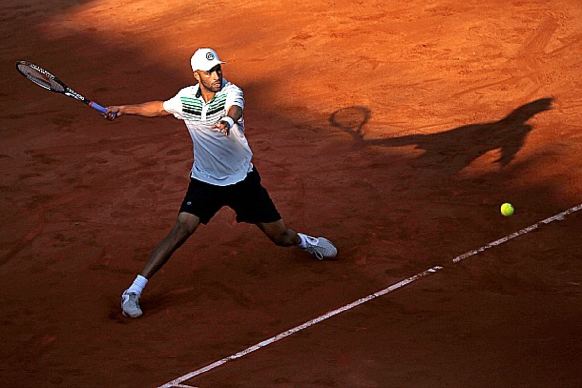 USA's James Blake hits a return to Serbia's Viktor Troicki during their French Tennis Open first round match at the Roland Garros stadium in Paris, on May 26, 2013. AFP PHOTO / THOMAS COEX (Photo credit should read THOMAS COEX/AFP/Getty Images)