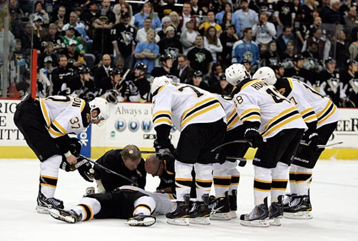 Marc Savard of the Boston Bruins lies on the ice after suffering a concussion.