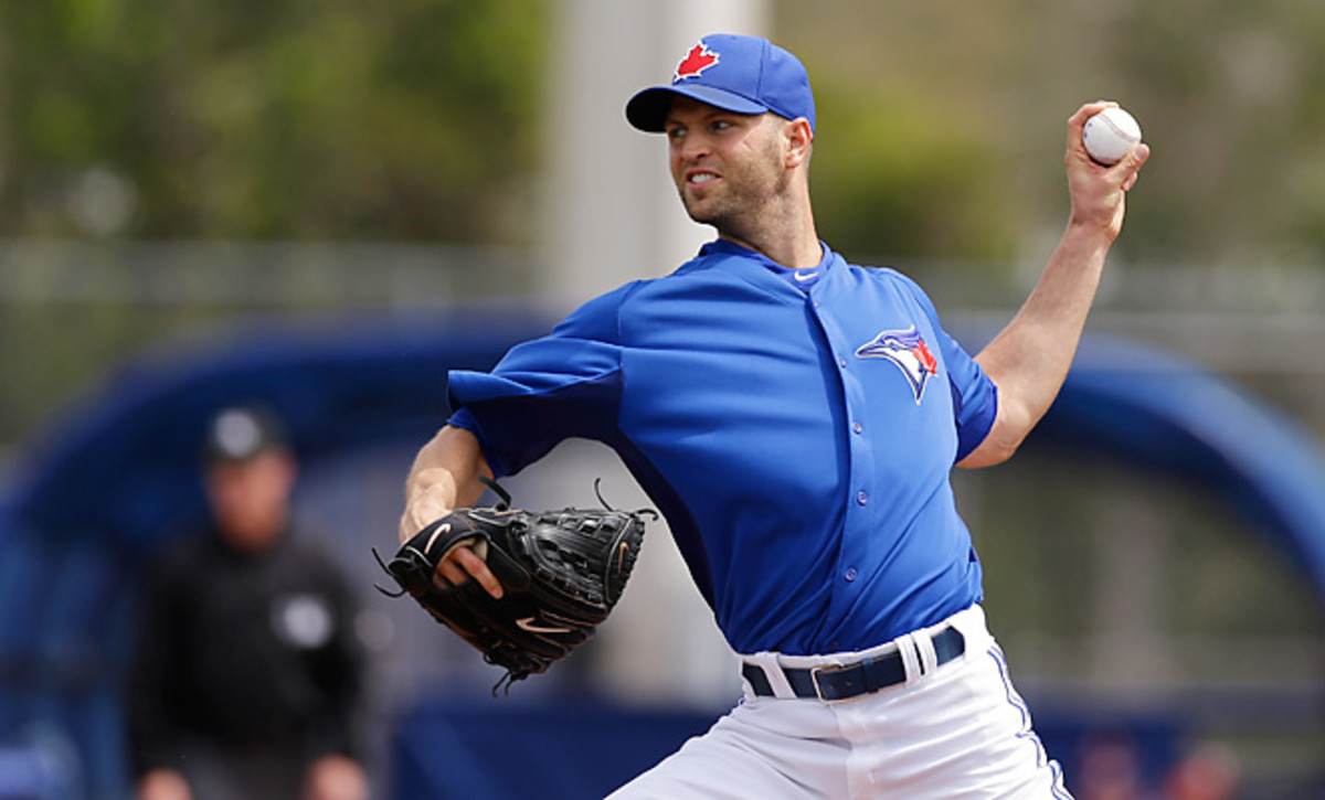 J.A. Happ pitches in a spring training game. Happ signed a two-year deal with the Blue Jays Wednesday.