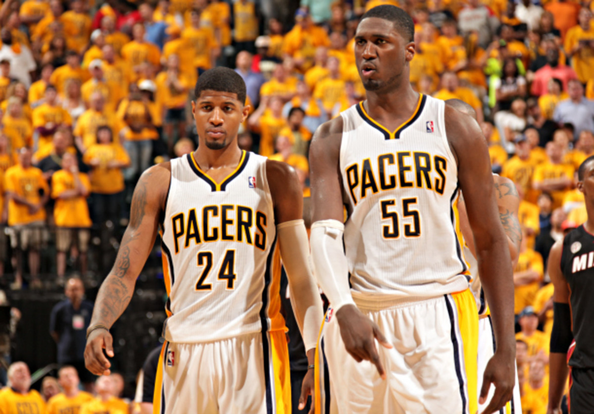 Paul George (left) and Roy Hibbert make up the Pacers' long-term core. (Ron Hoskins/NBAE via Getty Images)