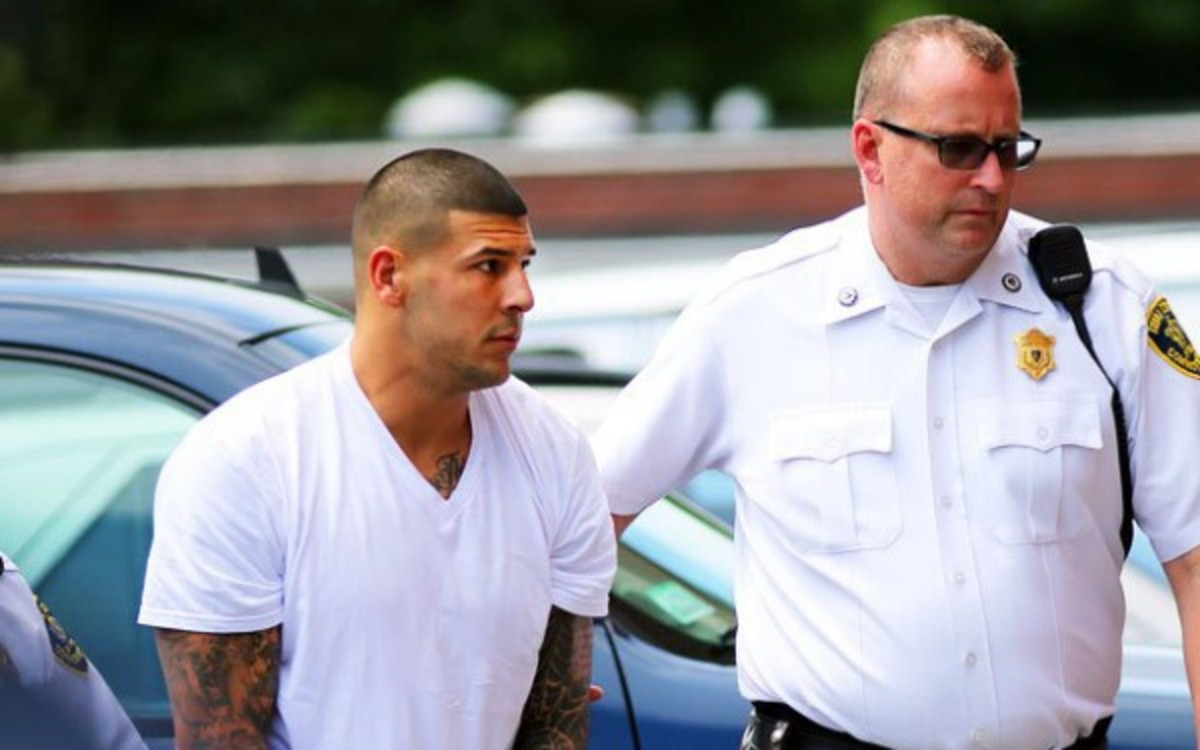 Aaron Hernandez is currently awaiting trial for the murder of Odin Lloyd.  (Getty Images)