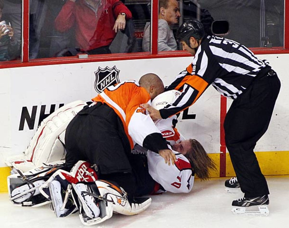 Ray Emery and Braden Holtby engage in a one-sided goalie fight.