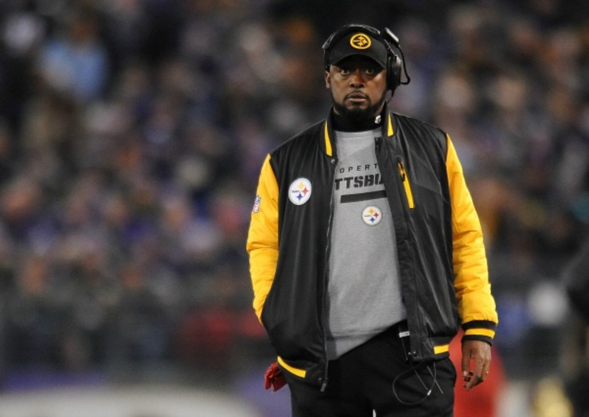 Mike Tomlin wandered on to the field of play during Jacoby Jones' 73-yard return. (AP)