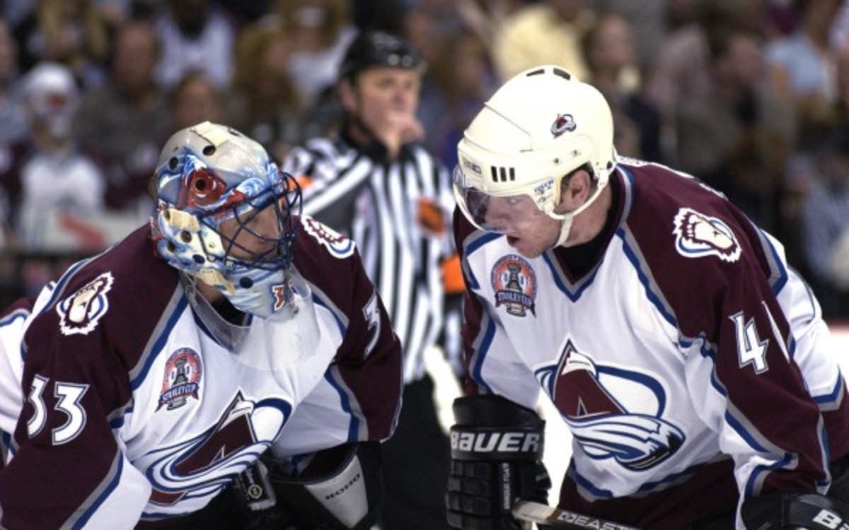 Patrick Roy and Alex Tanguay were teammates on the Avs' last Stanley Cup winner. (Elsa/Getty Images)