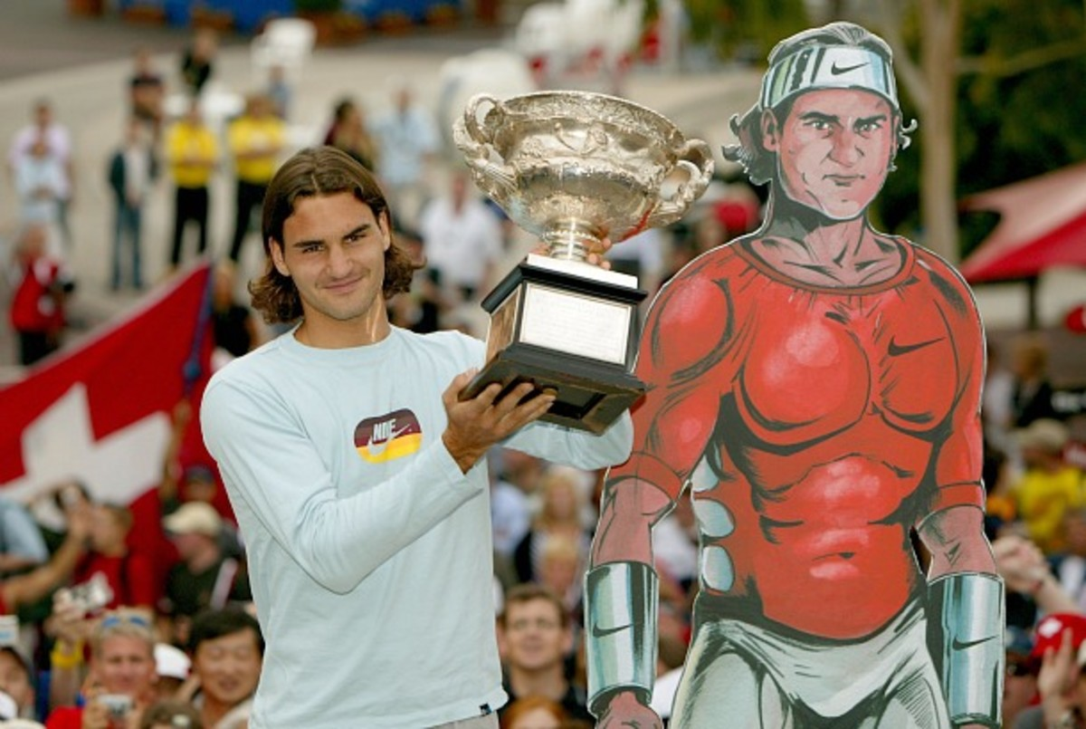 Federer shows off his trophy after winning the 2004 Australian Open (Clive Brunskill/Getty Images)