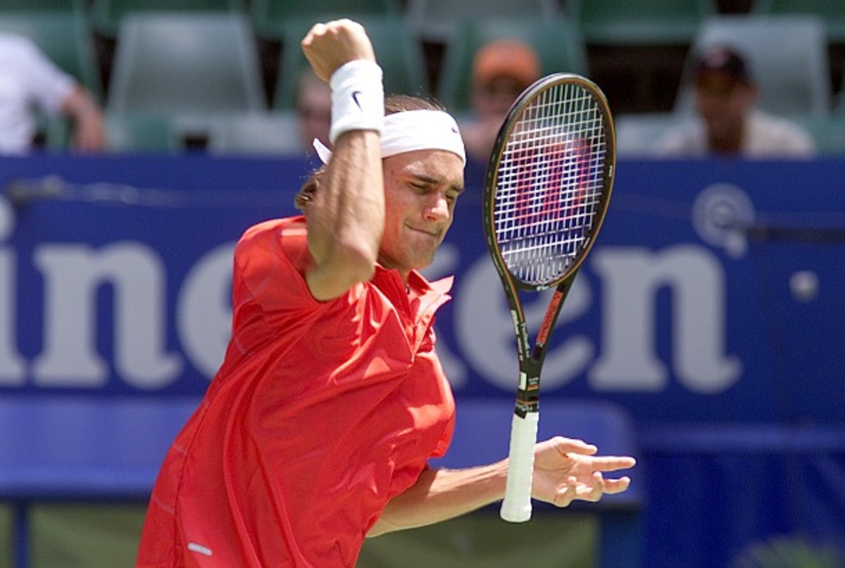 Federer gets frustrated during a loss a the 2001 Australian Open. (Adam Pretty/AllSport/Getty Images)