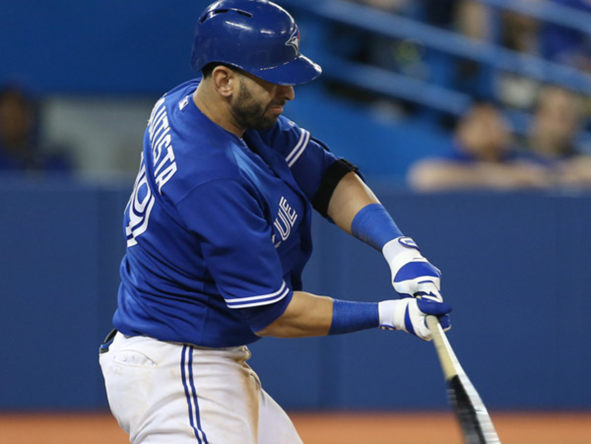 Jose Bautista drove in all four Toronto runs Wednesday against Tampa. (Tom Szczerbowski/Getty Images)