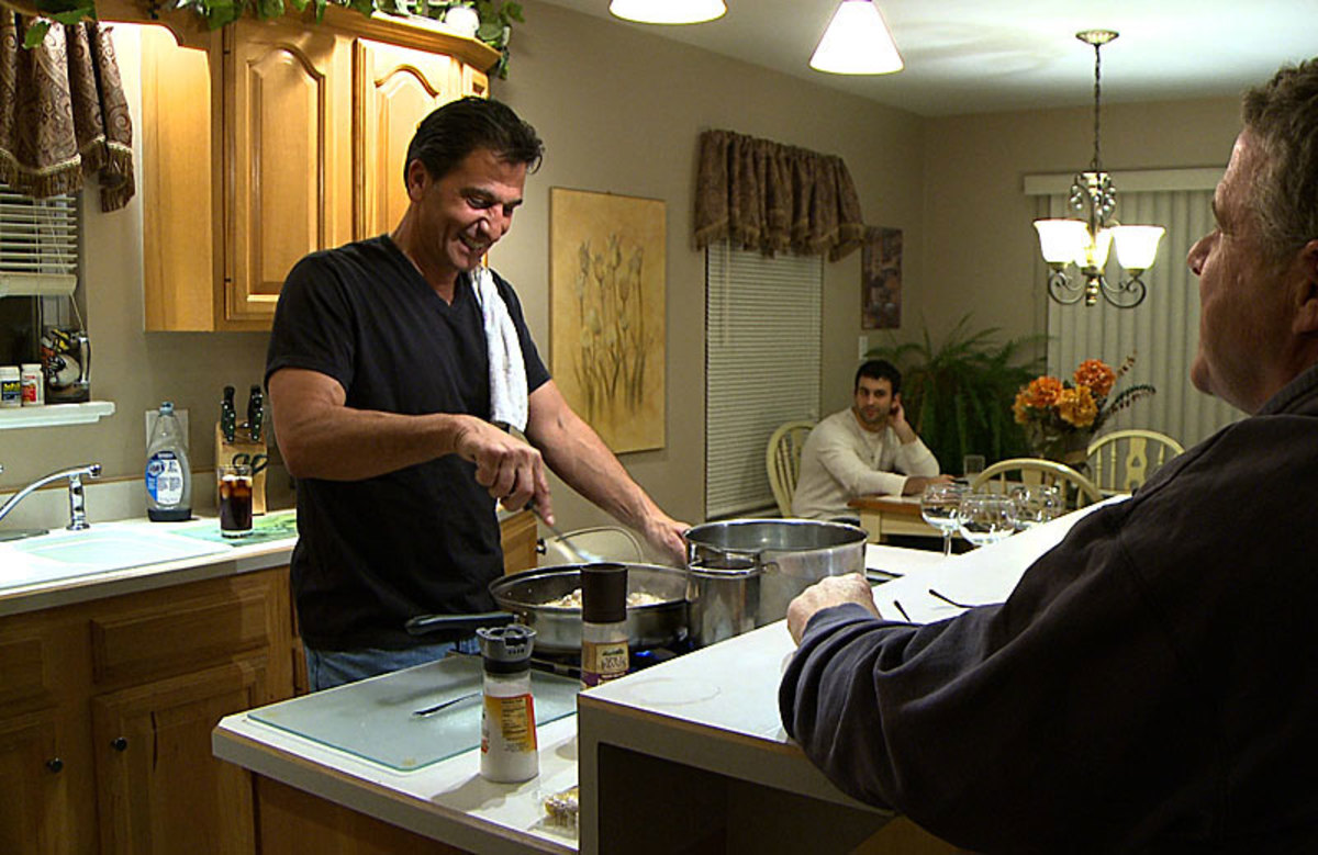 Gene Steratore, with son Geno in the background, in his kitchen a day after the Texans-Cardinals game in Arizona