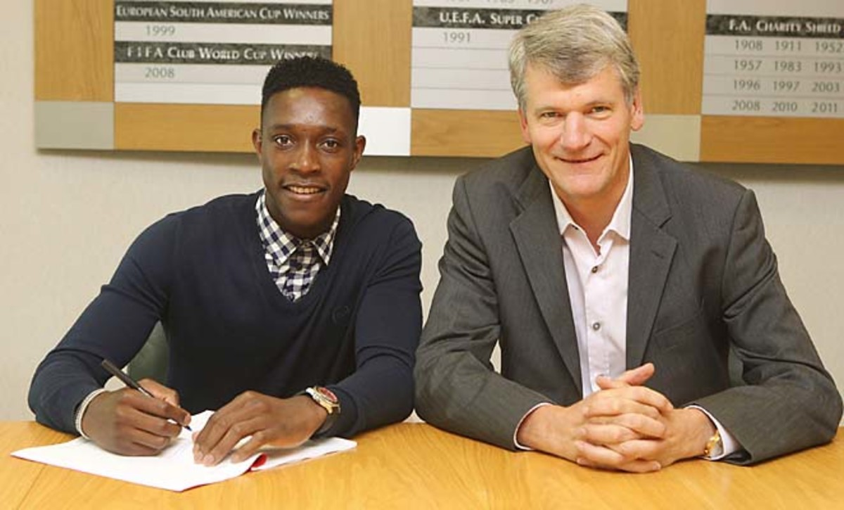 David Gill (right) poses with Danny Welbeck upon Welbeck signing an extension in August.