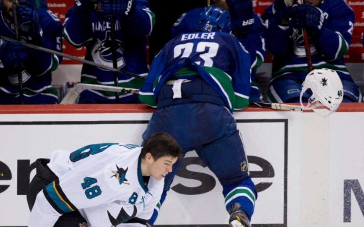 Canucks defenseman Alexander Edler was suspended three games without pay for this hit. (AP Photo/The Canadian Press, Darryl Dyck)
