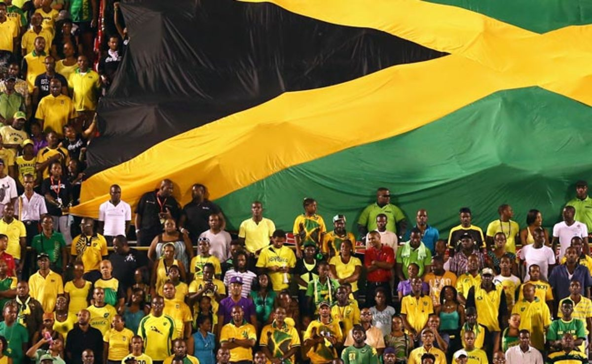 Jamaican fans unfurl a flag during their country's World Cup qualifier vs. the U.S. in June.