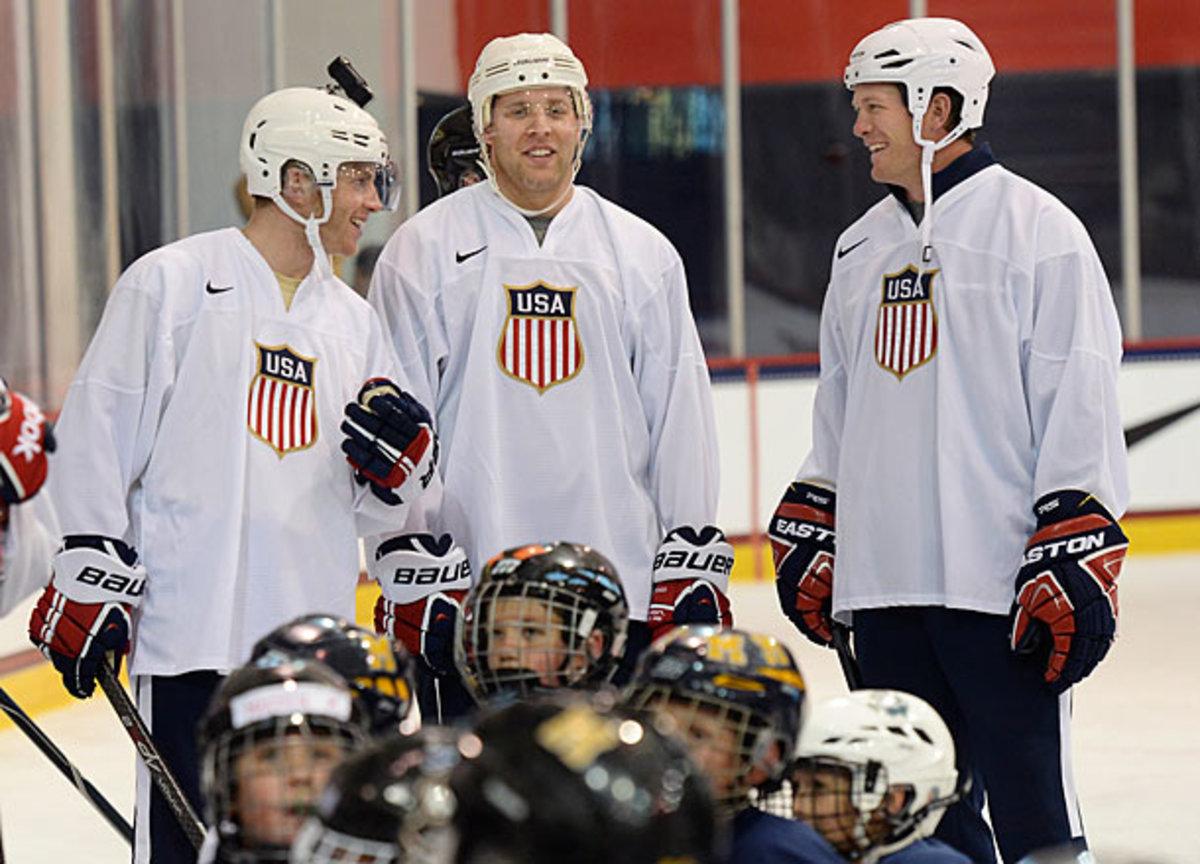 Patrick Kane, Jack Johnson and Ryan Suter of Team USA
