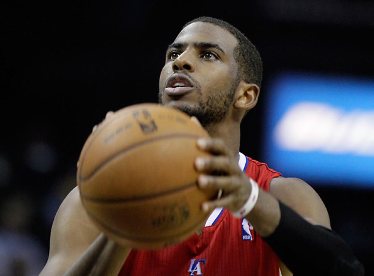 Chris Paul signed a five-year, $107 million extension with the Clippers Monday.