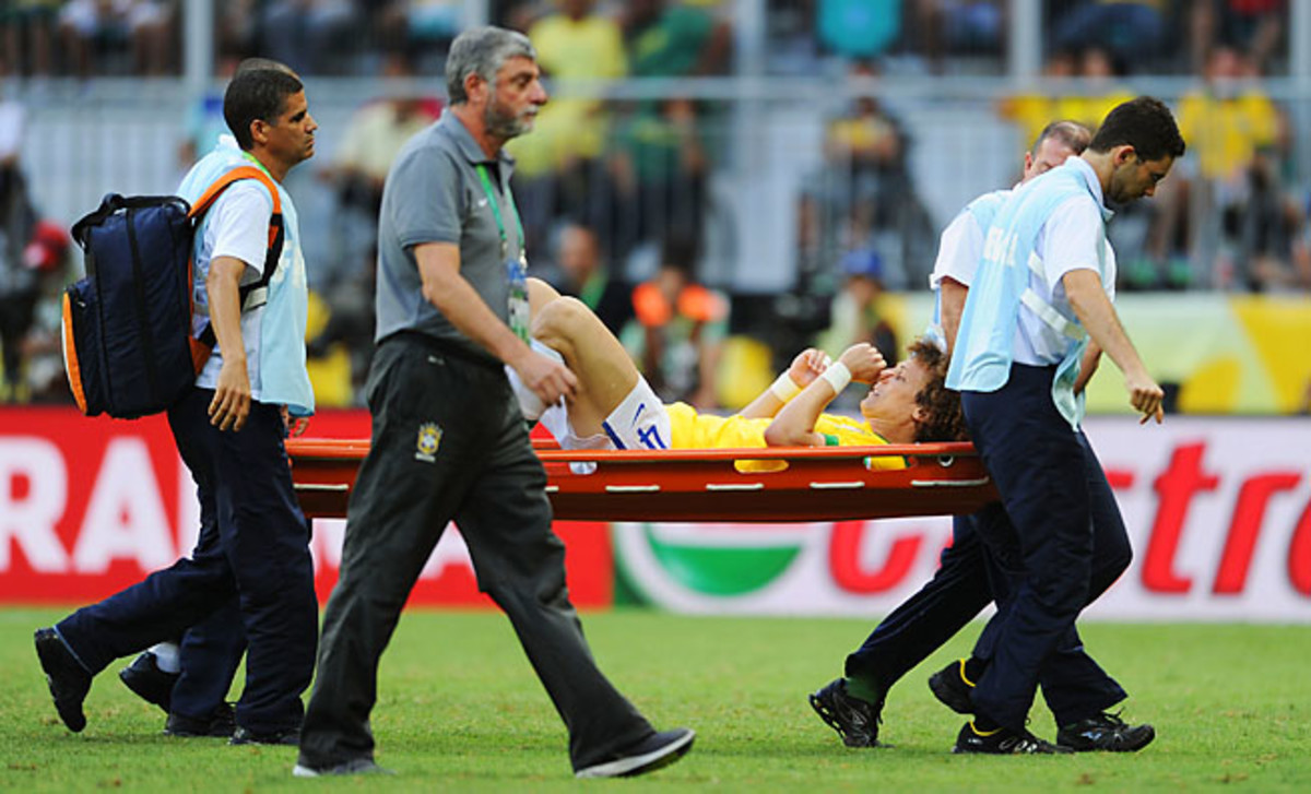 David Luiz is stretchered off a Group A match between against Italy on Sunday.
