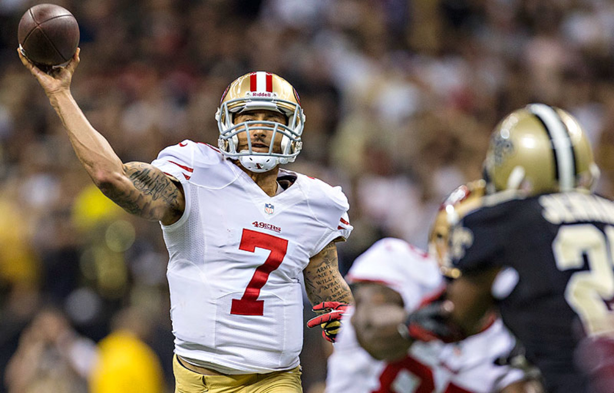 Colin Kaepernick's 56.2 completion percentage is last among NFL quarterbacks with at least 250 attempts this season. (Michael Zagaris/Getty Images)