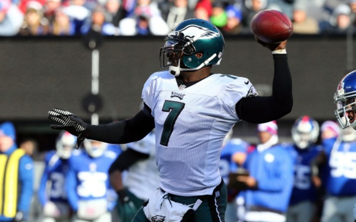 Eagles quarterback Michael Vick wants coach Chip Kelly to name a starting quarterback before training camp. (Jim McIsaac/Getty Images)