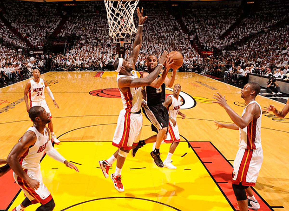 LeBron James led a Miami effort that held Tony Parker and the Spurs to 41 percent shooting in Game 2.
