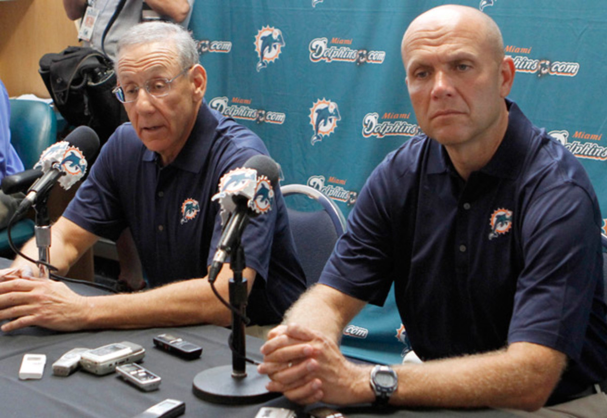 Mike Dee (right) spent four years as the CEO of the Miami Dolphins after seven years in Boston.