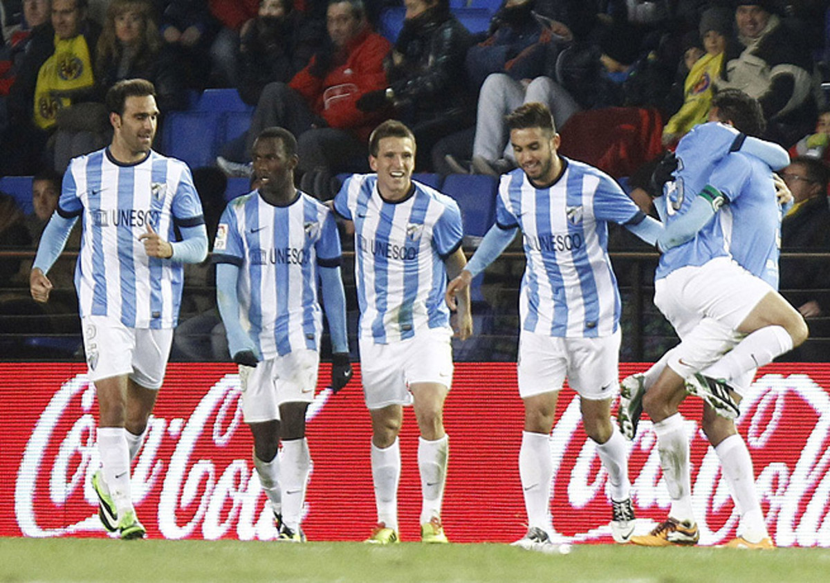 Malaga players celebrated after scoring a last-gasp tying goal against Villarreal.