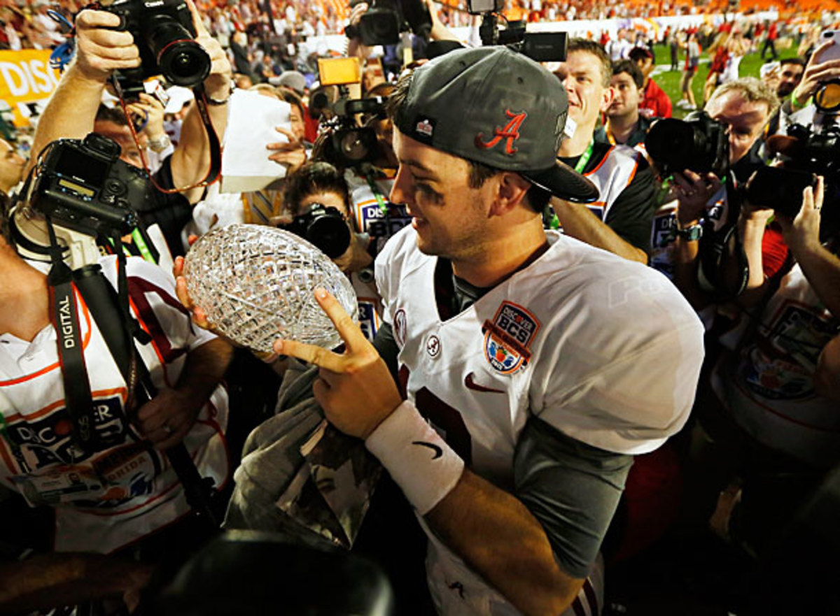 AJ McCarron meticulously examines 'Bama's latest BCS trophy for any cracks. (Kevin C. Cox/Getty Images)
