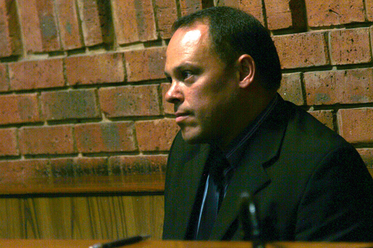 Word emerged that the former initial chief investigator Hilton Botha is facing attempted murder charges one day after he offered testimony to Oscar Pistorius' bail hearing.
