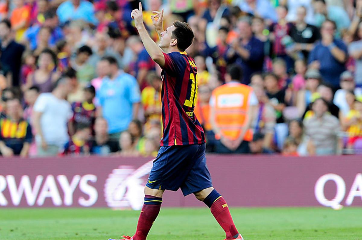 Lionel Messi scored twice in his first game under new Barcelona coach Gerardo Martino.