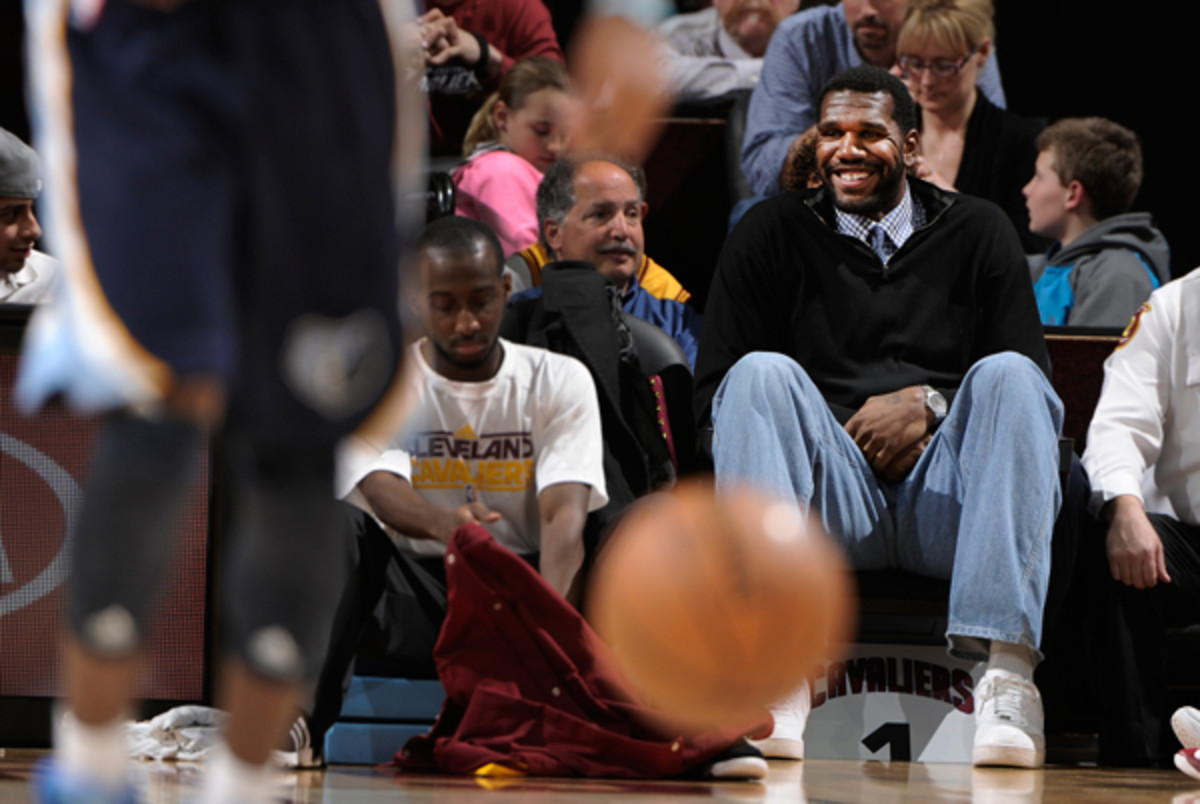 Greg Oden takes in a Cavaliers game from the stands. (David Liam Kyle/Getty Images)